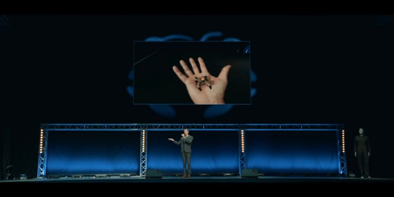 """A lecturer holds a killer drone in the palm of his hand in the short film """"Slaughterbots."""""""