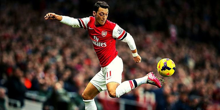 Mesut Özil during a soccer game, playing for Arsenal.