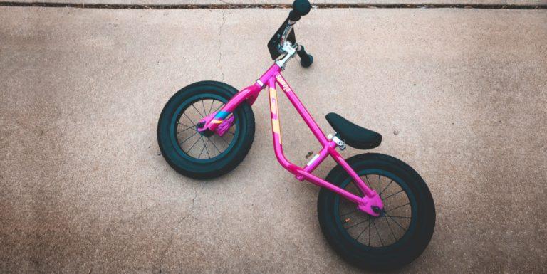 A pink balance bike