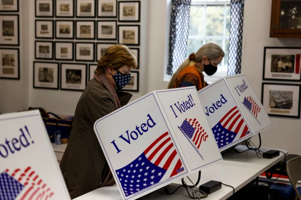 voters in 2020 us election fill out ballots at voting machines on ovemebr 3, 2020