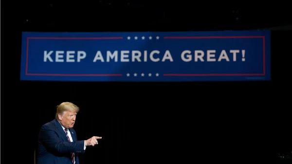 """Trump still has several paths to victory in the 2020 U.S. election, but faces steep legal hurdles in all of them according to legal schoalr Alan Dershowitz. President trump points in foreground of sign with words on slogan saying """"keep america great"""""""