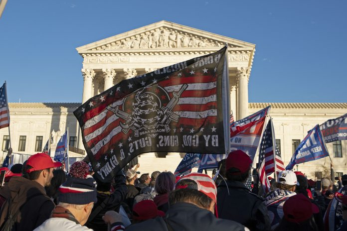 Supporters of US President Donald Trump participate in the Million MAGA March to protest the outcome of the 2020 presidential election in front of the US Supreme Court on December 12, 2020 in Washington, DC. Supporters of US President Donald Trump participate in the Million MAGA March to protest the outcome of the 2020 presidential election in front of the US Supreme Court on December 12, 2020 in Washington, DC. The Supreme Court on Dec. 11 rejected an election fraud-related lawsuit by the state of Texas.
