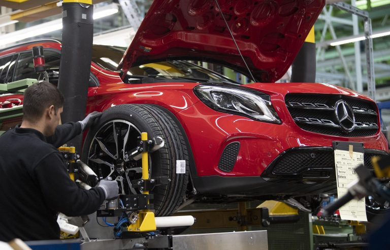 An employee mounts a wheel on a Mercedes Benz A Class on the assembly line at the Daimler AG factory in Rastatt, southwestern Germany, on February 4, 2019. - Daimler posts 2018 financial results on an annual press conference in Frankfurt Germany, on February 6, 2019. - Daimler posts 2018 financial results on an annual press conference in Frankfurt Germany, on February 6, 2019. - Daimler posts 2018 financial results on an annual press conference in Frankfurt Germany, on February 6, 2019. Daimler posts 2018 financial results on an annual press conference in Frankfurt Germany, on February 6, 2019.