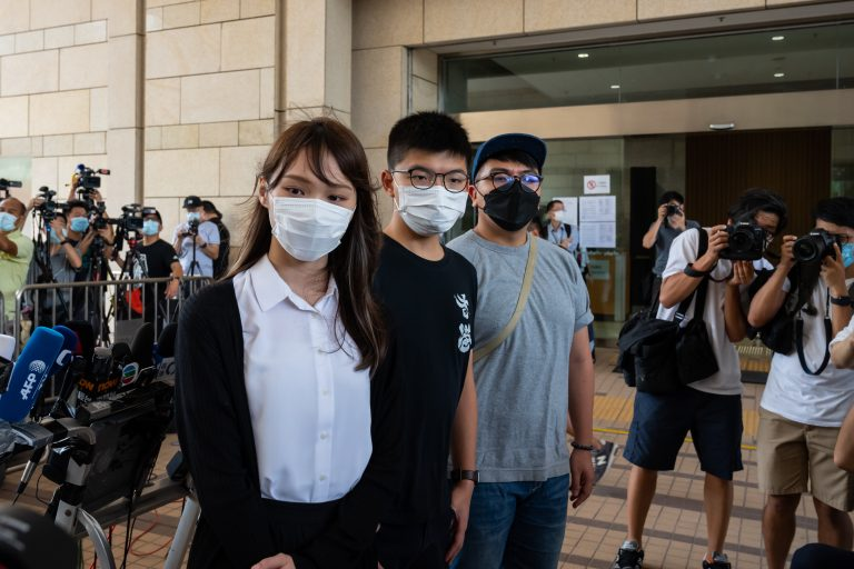 HONG KONG, CHINA - AUGUST5: Pro-democracy activist Agnes Chow Ting (L), Joshua Wong (C) and Ivan Lam Long-yin (R) speak to the press outside the court for illegal assembly charges in relation to a protest outside the city's police headquarters in June 2019, at West Kowloon Magistrates' Courts on August 5, 2020 in Hong Kong, China.