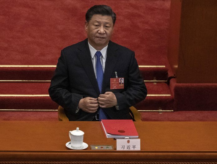 Chinese president Xi Jinping listens during the closing session of the National People's Congress, which included a vote on a new draft security bill for Hong Kong, at the Great Hall of the People on May 28, 2020 in Beijing, China. (Image: Kevin Frayer/Getty Images)
