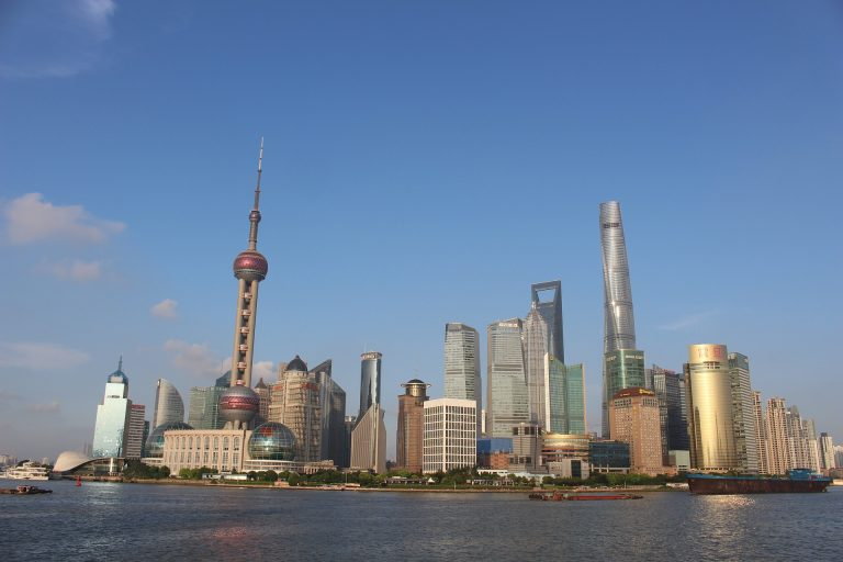 Chinese citizens have savings at a much higher rate than around the world. The photo is a stock image of Shanghai, China, on a clear day.
