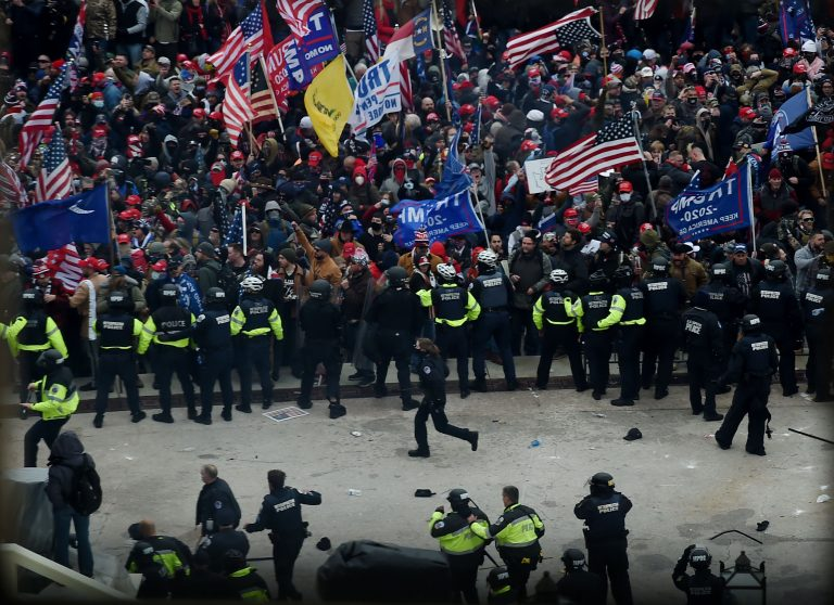 Police establish a line to hold back protesters as they gather outside the US Capitol's Rotunda on January 6, 2021, in Washington, DC. (Image: OLIVIER DOULIERY/AFP via Getty Images)