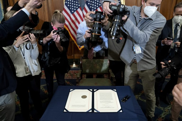 Photographers take pictures of the article of impeachment against President Donald Trump prior to it being signed at the U.S. Capitol on January 13, 2021 in Washington, DC. The House of Representatives voted to impeach Trump for incitement of insurrection, following Vice President Mike Pences refusal to use the 25th amendment to remove him from office for his role in the breach of the U.S. Capitol last week.