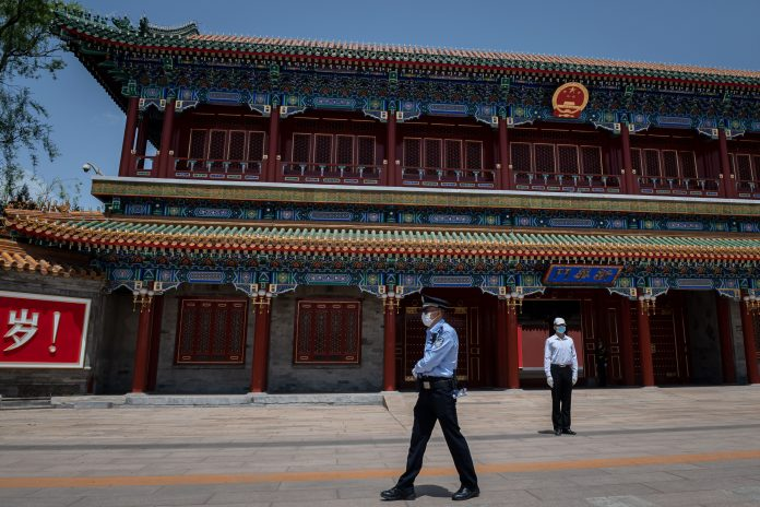 A security guard (R) and a police officer (L) secure the area at the entrance to the Zhongnanhai leadership compound in Beijing on May 18, 2020. (Image: NICOLAS ASFOURI/AFP via Getty Images) The CCP uses its United Front Work Department to control Chinese society and to exapdn influence among overseas elites.