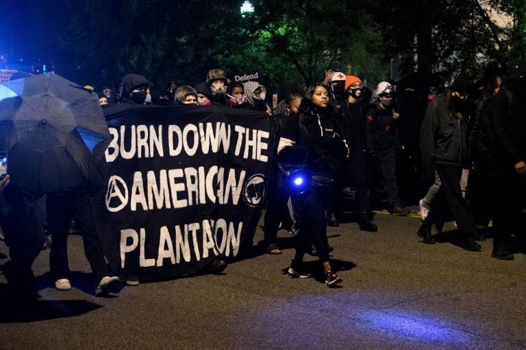 """People from Antifa and Black Lives Matter groups recently held a protest march through Washington D.C, with one video showing protesters chanting """"If we don't get it, burn it down"""" while walking through a residential neighborhood."""