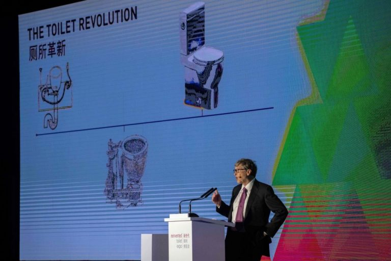 """Bill Gates gives a speech during the """"reinvented toilet expo"""" in Beijing on November 6, 2018."""