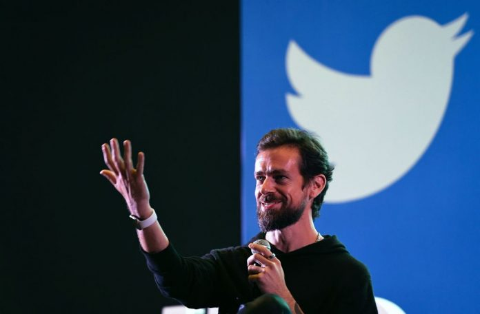 Twitter CEO and co-founder Jack Dorsey gestures while interacting with students at the Indian Institute of Technology (IIT) in New Delhi on November 12, 2018. Twitter's market capitalization has increased by more than $16 billion since banning Donald Trump from its platform.