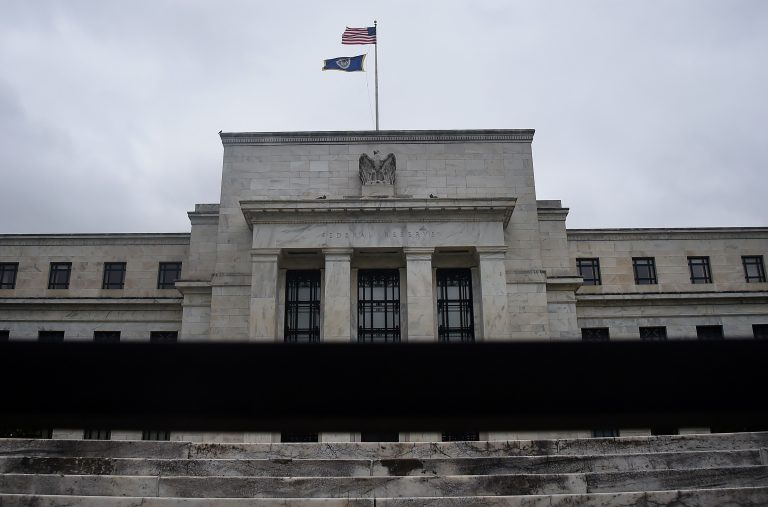 The Federal Open Market Committee's (FOMC) response to the current economic outlook is to hold interest rates steady between 0 and .25 percent.