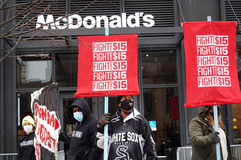 Demonstrators participate in a protest calling for minimum wage to be raised to $15-per-hour outside of McDonald's corporate headquarters on January 15, 2021 in Chicago, Illinois.