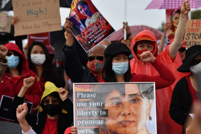 Protesters rally against the military coup and arrest of National League for Democracy (NLD) party leader Aung San Suu Kyi in Myanmar, at Parliament House on February 12, 2021 in Canberra, Australia