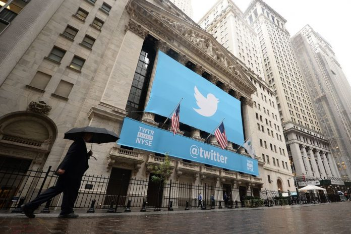 A banner with the logo of Twitter is set on the front of the New York Stock Exchange (NYSE) on November 7, 2013 in New York. Twitter revealed big plans to double its revenue and development efforts by Q4 2023 with a revolution of its platform during its 2021 Analyst Day