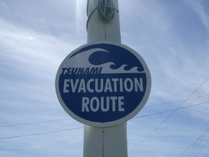 Tsunami Watch sign from Himitangi Beach in New Zealand taken in 2007. A trio of 7 to 8 magnitude earthquakes struck off the northeastern coast of the island country of New Zealand on Friday, triggering a tsunami warning and evacuation of coastal residents