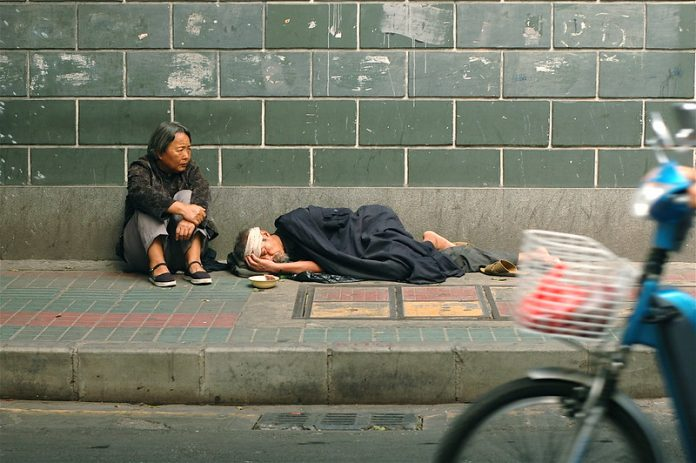 While the Communist regime claims that Chinese poverty was defeated in 2020, many households still fall below the World Bank's poverty line of US $5.50 for upper-middle-income countries such as China. Beggars are pictured on the streets of Guangzhou, China