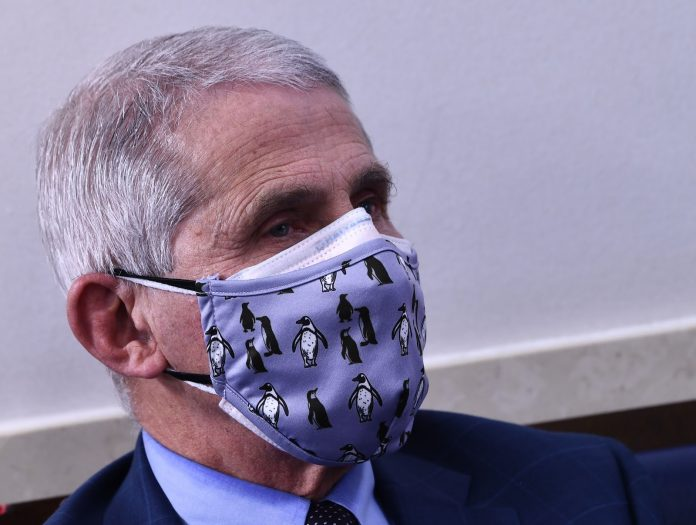 Dr. Anthony Fauci, chief medical advisor to President Biden, has a stern warning for people who have been inoculated with the COVID-19 vaccines: continue to observe coronavirus restrictions.