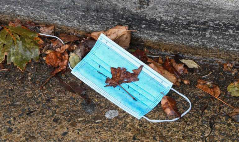 A used face mask sits in the side gutter approaching the Harbour Bridge on April 10, 2020 in Sydney, Australia. On March 11, a Florida Governor Ron Desantis Executive Order struck down all fines issued by local governments in the SARS-CoV-2 pandemic.