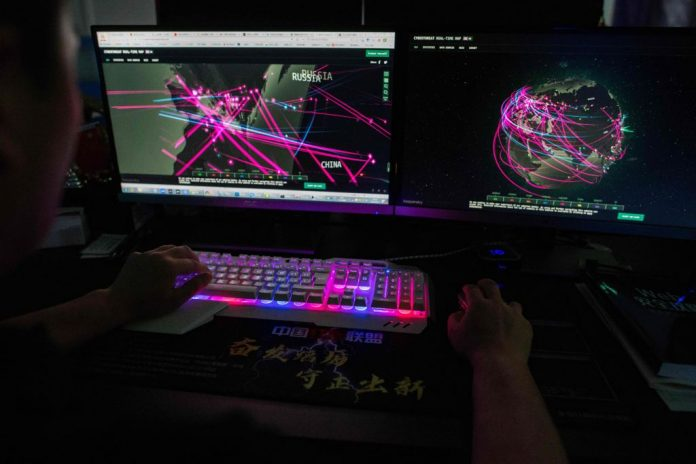 Prince, a member of the hacking group Red Hacker Alliance who refused to give his real name, claims to show a website that monitors global cyberattacks on his computer at their office in Dongguan, China's southern Guangdong province. Chinese communist state hackers have been using a zero-day exploit on Microsoft Exchange Server email servers since January