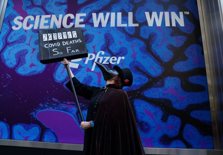 """Pro-vaccine demonstrators hold a """"Free the Vaccine"""" rally in front of the Pfizer Headquarters in New York on March 11. Pfizer's CEO Albert Bourla said his company would be expanding their mRNA vaccine business beyond the COVID-19 pandemic"""