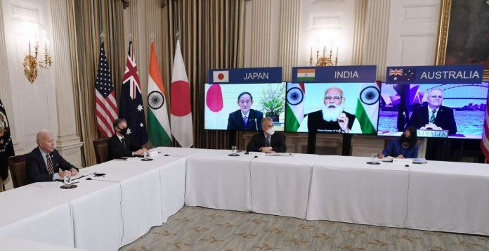 US President Joe Biden (L), with Secretary of State Antony Blinken (2nd L), meets virtually with members during the Quad Summit of Australia, India, Japan and the U.S., in the State Dining Room of the White House in Washington, D.C., on March 12, 2021. While the Quad focused on countering the Chinese Communist Party in the Asia-Pacific region under President Trump, the emphasis has instead changed to vaccine diplomacy and carbon-based climate change issues.