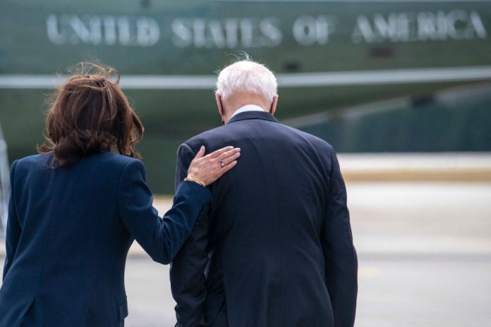 U.S. President Joe Biden (R) and U.S. Vice President Kamala Harris arrived at Dobbins Air Reserve Base in Marietta, Georgia, on March 19, 2021. While Biden and Harris were busy in Atlanta, Georgia, to tour the Centers for Disease Control and Prevention, and to meet with Georgia Asian American leaders, photos of packed cells of the Donna migrant camp were leaked to Project Veritas. Neither member of the Executive Branch has committed to visiting the southern border amid the migrant crisis.