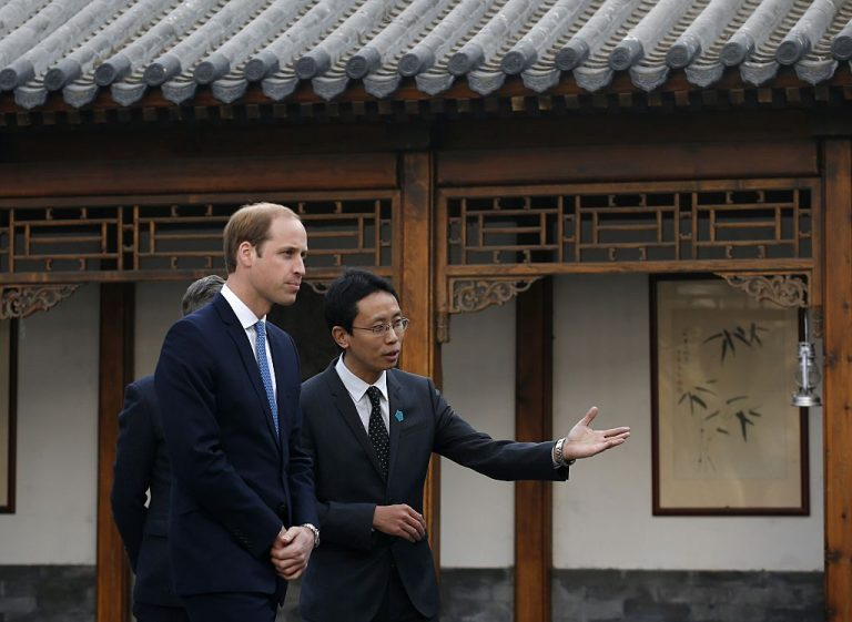 Britain's Prince William (L) is guided by Matthew Hu, China representative of the Prince's School of Traditional Arts, during a visit to the Shijia Hutong in Beijing on March 2, 2015