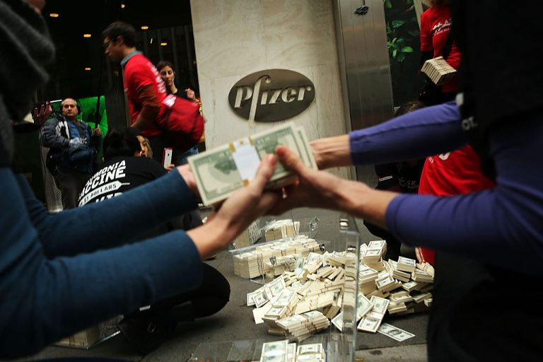 Volunteers with Doctors Without Borders dump $17 million in fake money outside of Pfizer's headquarters to protest high vaccine prices on November 12, 2015 in New York City. Authorities busted a South African crime ring connected to Communist China selling COVID-19 counterfeit vaccines