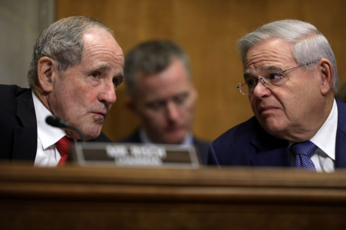 Senate Foreign Relations Committee Chairman James Risch (R-ID) (L) and ranking member Sen. Robert Menendez (D-NJ) talk during a hearing in the Dirksen Senate Office Building on Capitol Hill December 03, 2019, in Washington, DC. U.S. Senators laid out major bipartisan-sponsored legislation, dubbed the Strategic Competition Act of 2021