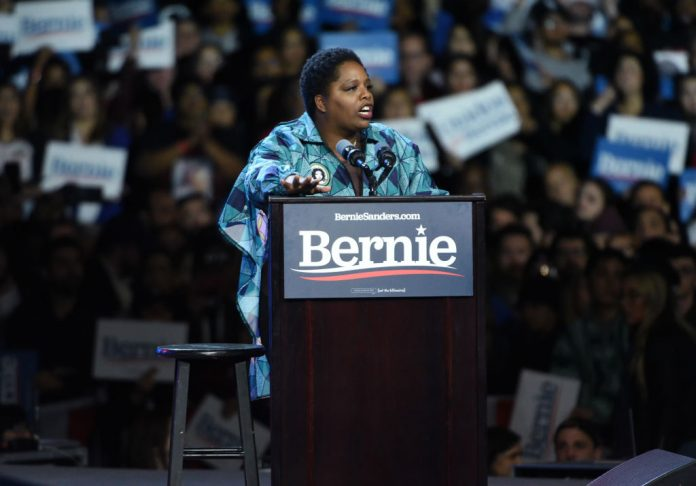 "Black Lives Matter co-founder Patrisse Cullors, a self-described ""trained Marxist,"" speaks at a Bernie Sanders 2020 presidential campaign rally at Los Angeles Convention Center on March 1, 2020 in Los Angeles, California. Research by the National Legal and Policy Center using publicly available databases revealed Cullors has been amassing a fortune of mansions and property in elite white neighbourhoods. She claims her riches are to take care of her family."