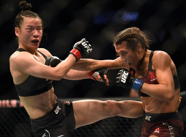 Zhang Weili takes a punch form Joanna Jedrzejczyk in a Zhang split decision win at T-Mobile Arena on March 7, 2020 in Las Vegas, Nevada. Rose Namajunas will fight Zhang for the title on April 24.
