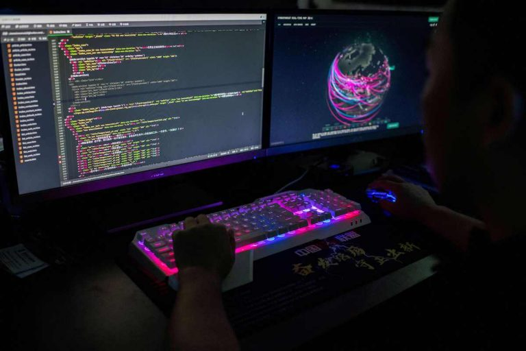 This photo taken on August 4, 2020 shows Prince, a member of the hacking group Red Hacker Alliance, using a website that monitors global cyberattacks on his computer at their office in Dongguan, China's southern Guangdong province. American authorities have recognized the threats posed by Chinese supercomputing companies.