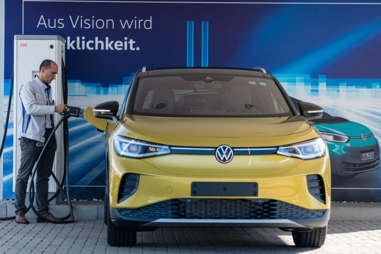 A worker charges the new Volkswagen ID.4 electric sport utility vehicle (SUV) at the VW factory on September 18, 2020 in Zwickau, Germany. VW's recent 'Voltswagen' April Fools promotional gaffe only puts lipstick on the shortcomings of shifting to an electric vehicle paradigm.