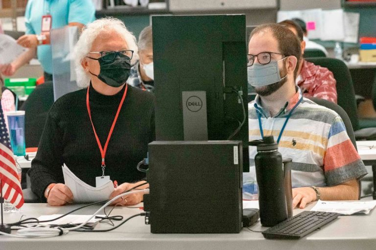 Poll workers count ballots inside the Maricopa County Election Department in Phoenix, Arizona on November 5, 2020 - A bill that will prohibit private funding of election administration and management has passed through both Arizona's House and Senate.