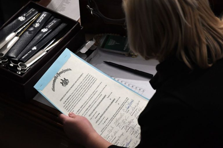 A person holds the certificate of votes from the commonwealth of Pennsylvania during theJoint Session of Congress after the session resumed following protests at the US Capitol in Washington, DC, early on January 7, 2021.