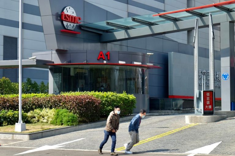 People walk past the headquarters of the world's largest semiconductor maker TSMC in Hsinchu on January 29, 2021. Taiwan is strengthening laws meant to prevent the Chinese Communist Party from stealing its tech industry's trade secrets and experts.