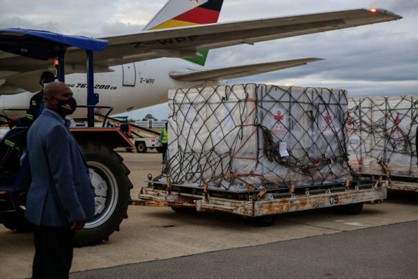 An inspector is seen next to the Sinopharm vaccine shipment awaiting unloading at Harare International Airporton February 15, 2021 in Harare, Zimbabwe. The African nation's population is exceptionally weary of accepting made-in-China vaccines imported by its CCP-aligned government.