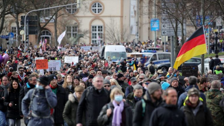 Protestors take part in a march demanding basic rights and freedoms in a democratic society, calling for an end to draconian coronavirus measures in Kassel, central Germany, on March 20, 2021.