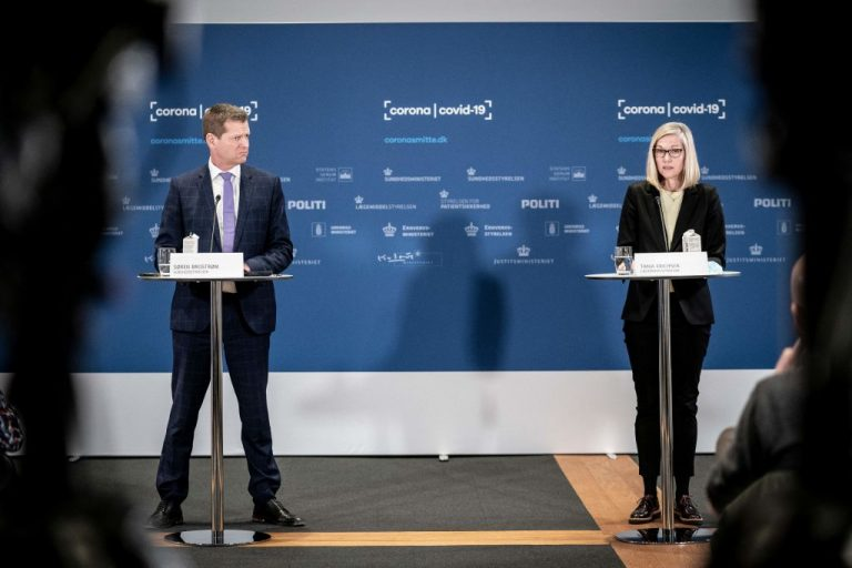 Soeren Brostroem, director of the National Board of Health (L) and Tanja Erichsen, from Danish Medicins Agency announced the suspension of the AstraZeneca adenovirus vector variant from distribution in Denmark. Erichsen fainted during the conference and was rushed to hospital.