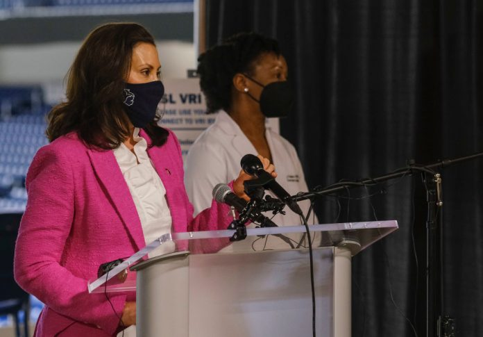 DETROIT, MI - APRIL 06: Michigan Governor Gretchen Whitmer speaks to members of the press about the rising numbers of Covid-19 cases in Michigan and the vaccine availability before receiving a dose of the Pfizer Covid vaccine at Ford Field on April 6, 2021 in Detroit, Michigan. As the US reaches a milestone in vaccinations, a surge of new Covid-19 cases has swept through the US with Michigan seeing the highest numbers of new cases.