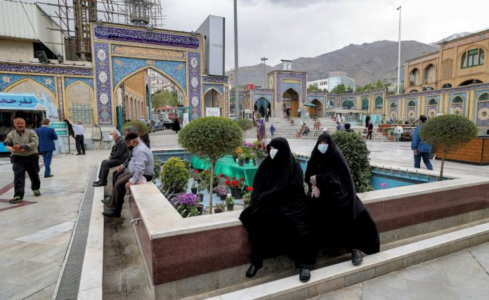 Women sit by a fountain converted into a flowerbed in the courtyard of the Emamzadeh Saleh shrine in the Shemiran district of Iran's capital Tehran on April 14, 2021 on the first day of the Muslim holy fasting month of Ramadan in Iran. The Islamic regime, notorious for its abuse of women's human rights, was voted to the UN Commission on the Status of Women on April 20 and will join China, Pakistan, Lebanon, and Japan