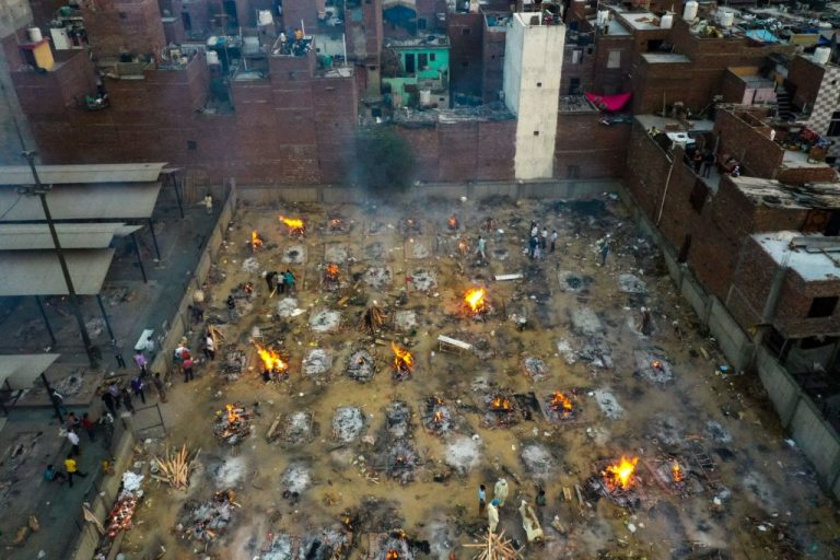 In this aerial picture taken on April 26, 2021, burning pyres of victims who lost their lives due to the Covid-19 coronavirus are seen at a cremation ground in New Delhi. India's official death count and positive test count has increased by a factor of ten over the last six weeks.