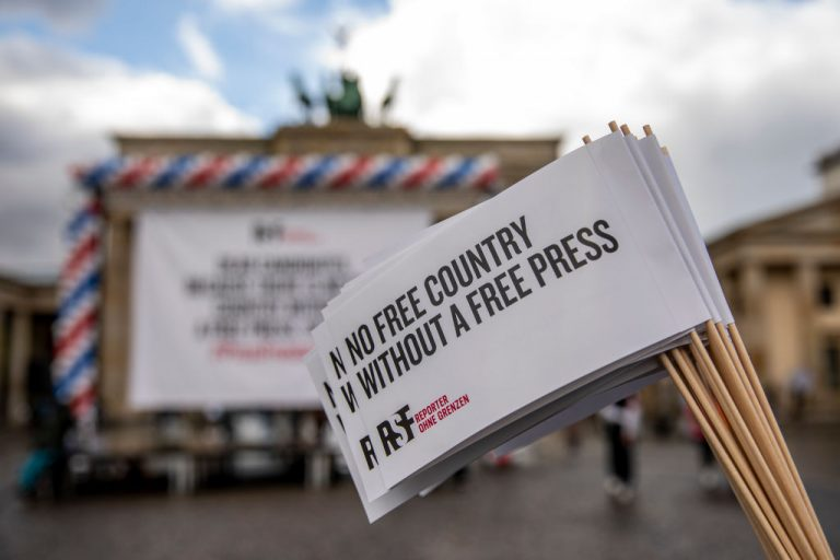 Supporters of Reporters Without Borders (RSF) protest in front of the The Brandenburg Gate on October 7, 2020 in Berlin, Germany. RSF's annual Press Freedom Index was cautious to draw the correct parallel between increasing media and information censorship found in America, relying on the SARS-CoV-2 pandemic as an excuse, and how the Chinese Communist Party conducts business in its territory.