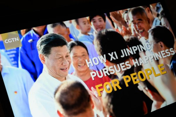 "The title screen of a CCP propaganda segment titled ""How Xi Jinping Pursues Happiness For People"" from the CGTN archive is seen as it plays on a computer monitor on February 04, 2021, in London, England."