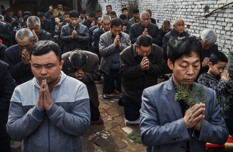 Chinese Catholic worshippers at Palm Sunday Mass during the Easter Holy Week at an unofficial church on April 9, 2017 near Shijiazhuang, Hebei Province, China. China places a number of restrictions on Christians, allowing legal practice of the faith only at state-approved churches. The policy has driven an increasing number of Christians to secretly congregate in private homes and other venues.