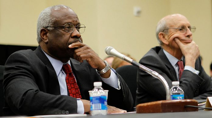WASHINGTON - APRIL 15: U.S. Supreme Court Justices Clarence Thomas (L) and Stephen Breyer (R) testify during a hearing before the Financial Services and General Government Subcommittee of the House Appropriations Committee April 15, 2010. Justice Clarence recently addressed censorship issues, and the absolute authority that social media platforms have over user accounts.