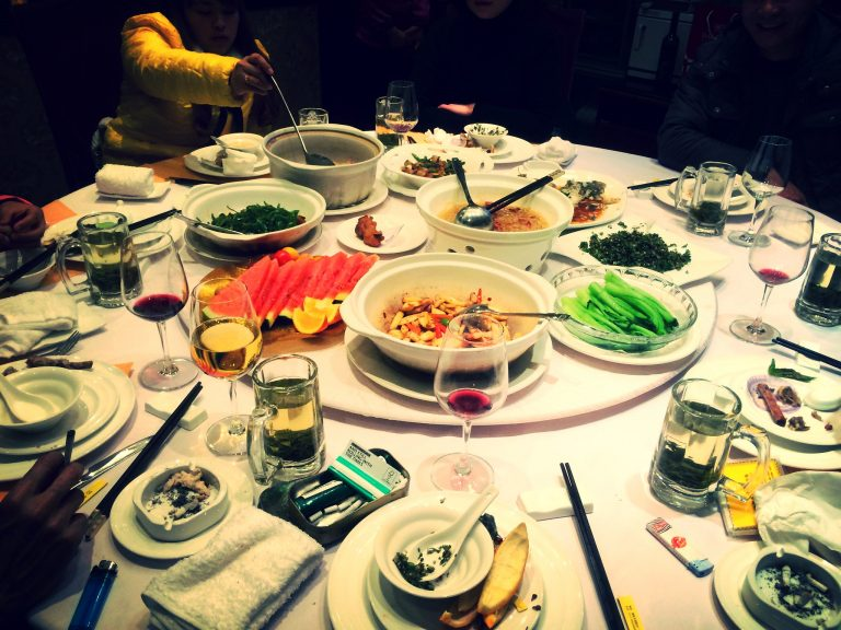 An array of dishes served at the table of a restaurant in China.