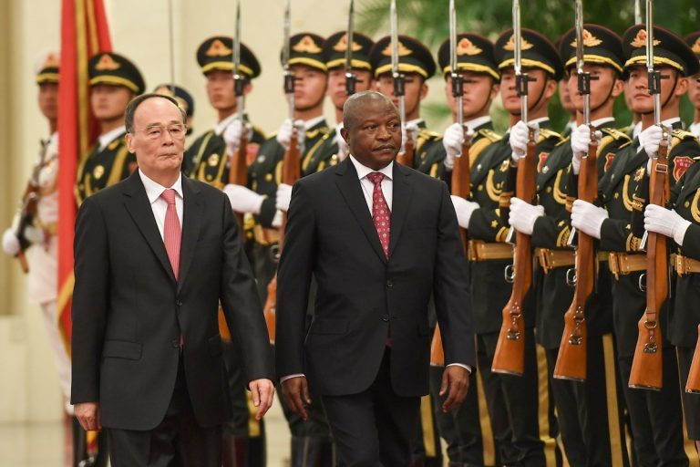 South Africa's Deputy President David Mabuza reviews a military honour guard with Chinese Vice President Wang Qishan during a welcome ceremony at the Great Hall of the People in Beijing on October 31, 2019.